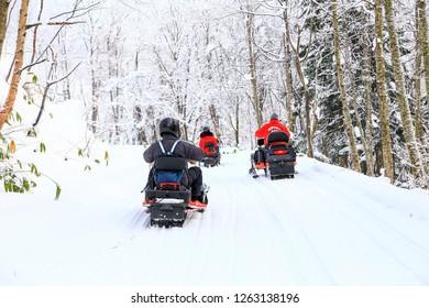 Hokkaido, Japan - Dec 17, 2018 : The touris ride snow moblie in Snow forest at Hokkaido, Japan.