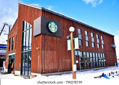Hokkaido, Japan - January 31, 2016: People visit Starbucks coffee shop in Hakodate, Japan which built in the old cargo at the port