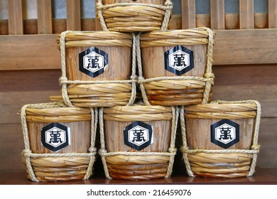 HOKKAIDO, JAPAN - JULY 10 2014 : Sake kegs are offered at Hokkaido Jingu Shinto Shrine
