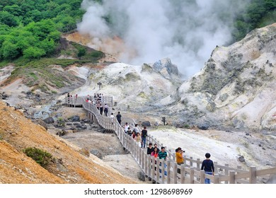 Hokkaido, Japan -  July 13 ,2018: Many tourists toke a look Famous Noboribetsu Jigokudani (Hell Valley), the explosion crater trace which was made by the eruption of Mt. Hiyoriyama.