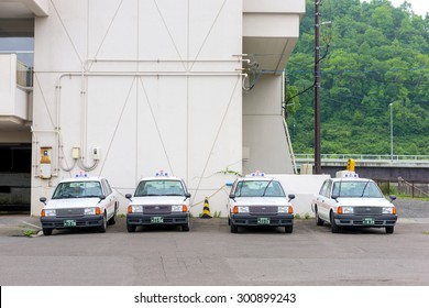 HOKKAIDO, JAPAN - JULY 21, 2015: Taxi in Toya, Hokkaido, Japan. Taxi in japan is one of the most expensive in the world.