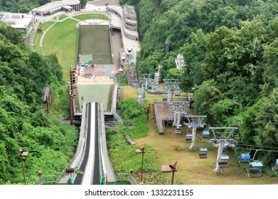 Hokkaido, Japan - July 22, 2018: Okurayama Observatory (Okurayama Ski Jump) with Sapporo cityview in the cloud, Hokkaido, japan