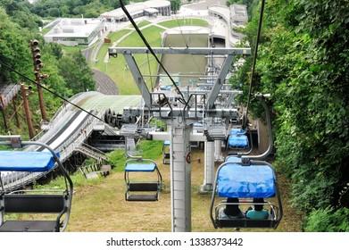 Hokkaido, Japan - July 22, 2018: Chair lift moving from the top of Sapporo ski jump observatoy, Hokkaido, japan.