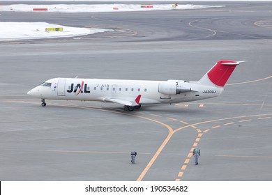HOKKAIDO, JAPAN - MARCH 18, 2014: JAL Express Bombardier Jet CRJ-200LR at New Chitose Airport, Japan. The Officials Bow for salute to the pilots and passengers which is tradition of Japanese.