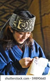 HOKKAIDO, JAPAN - NOVEMBER 17 :  Ainu Woman sewing in Shiraoi Ainu Museum on November 17,2009 in Hokkaido, Japan. Shiraoi Ainu Museum called Porotokotan, is one of Hokkaido's better Ainu Museums