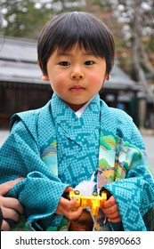 HOKKAIDO, JAPAN - NOVEMBER 19 :  Japanese boy in kimono on November 19,2009 in Hokkaido, Japan. He dress up for Shichi-Go-San festival (3 and 7 year-old girls and 3 and 5 year-old boys)