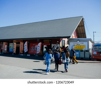 HOKKAIDO, JAPAN : September 21, 2018 - Group of tourists walking to Asahikawa Ramen Village in Hokkaido, Japan.