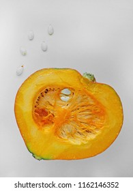 Hokkaido pumpkin or Red kuri squash (often spelled 'kari'),thin skinned orange colored winter squash, that has the appearance of a small pumpkin without the ridges.White background, top view, flat lay