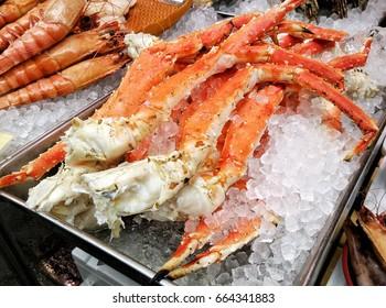 Hokkaido Steamed Crab legs sold on seafood market, Japan.