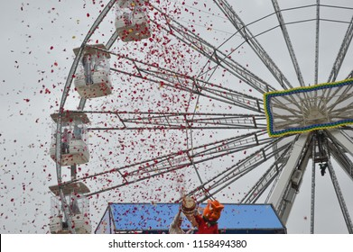 HOLAMBRA, SAO PAULO, BRAZIL - 20-SEPTEMBER, 2014: traditional rain of petals at the end of 33ª Expoflora Flower Fair in Holambra