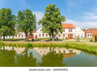 HOLASOVICE,CZECH REPUBLIC - JUNE 20,2019 - View at the Houses with pond in Holasovice. Holasovice is a small historic village located in the south of the Czech Republic