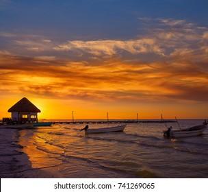 Holbox Island pier palapa sunset beach in Mexico Quintana roo