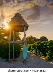 Holbox Island sunrise baywatch tower and surf board in Quintana Roo Mexico