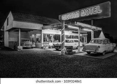Holbrook, Arizona USA - September 5, 2017: Famous Wigwam Motel on Historic Route 66 photographed at night in black and white in Holbrook, Arizona USA
