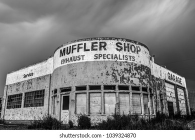 Holbrook, Arizona USA - September 5, 2017: Abandoned Auto Shop on Historic Route 66 photographed at night in black and white in Holbrook, Arizona USA