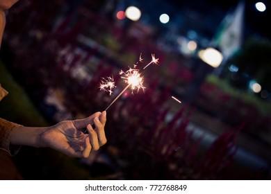 hold firesparkler blink in hand at night toning