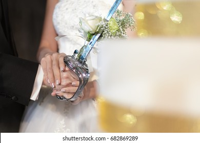 Hold hands in wedding