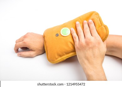 Hold a hot water bottle in the arm.