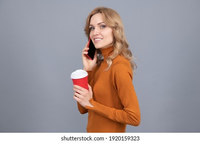 Hold the line please. Pretty woman talk on phone holding cup. Modern technology. Mobile communication. Mobile coffee or espresso anytime anywhere.