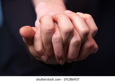 Hold my hand. Close up of young caucasian couple holding hands