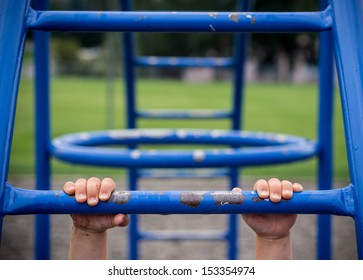 Hold on to monkey bars at playground