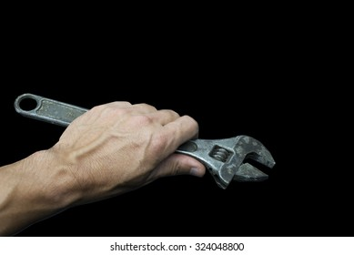 hold wrench in your hand and in black background
