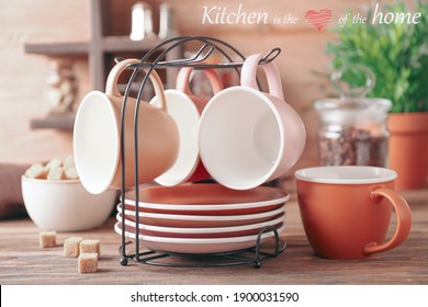 Holder with cups and saucers on kitchen table