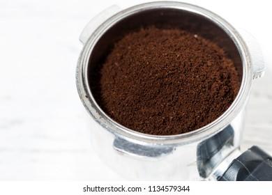 holder with ground coffee for coffee machine, closeup horizontal