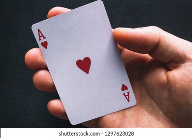 holding an ace card close up