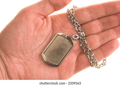 holding an army ID disc  in hand