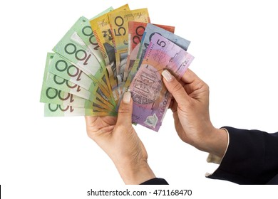 Holding Australian dollar banknotes  in hand in white background.