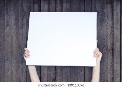 Holding Banner on Wood Background