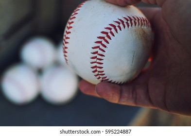 Holding a baseball to pitch for the game.  Good for decor, print or background for sports or athlete themes.