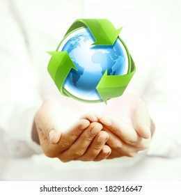 Holding blue earth and recycling arrows