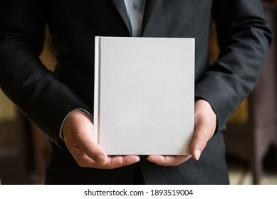 Holding a book for business or education