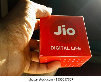 Holding a boxed Reliance Jio Digital device - jiofi wifi mobile hotspot - before unboxing [Chennai, TN, India - March 12, 2019]