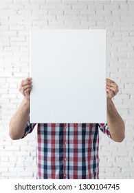 Holding canvas mockup. Photo Mockup. The man hold canvas. For canvas design. Frame size 16x20 (40x50cm).