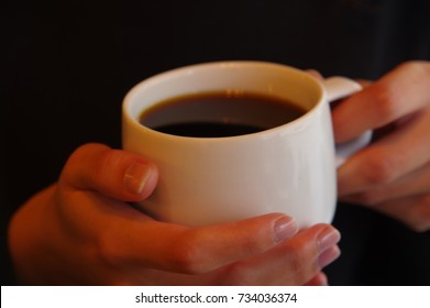 holding coffee