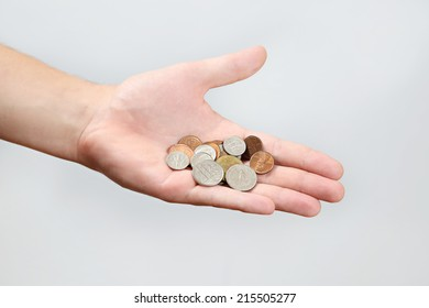 Holding Coins, US dollars coins in a flat male hand