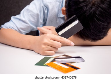 holding a credit card - debt with spending