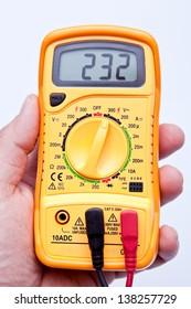 holding digital multimeter