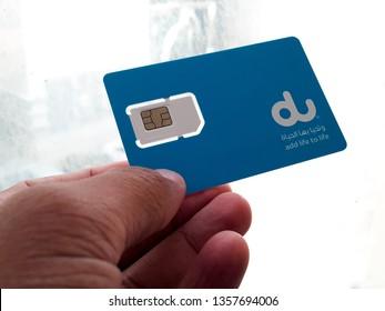 Holding a Du Sim Card [Abu Dhabi, United Arab Emirates May 20, 2018]