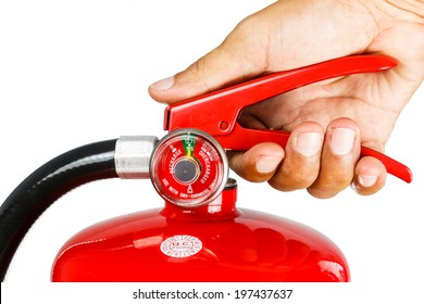 Holding fire extinguisher isolated over white background, with clipping path