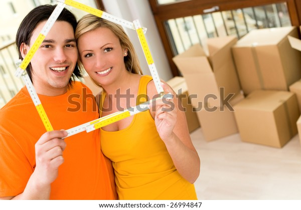 holding folding ruler in the shape of a house
