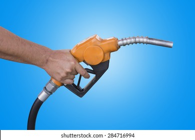 Holding a fuel nozzle against blue background