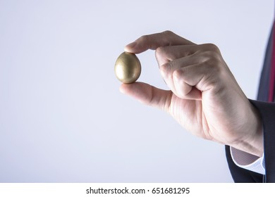 Holding a golden egg