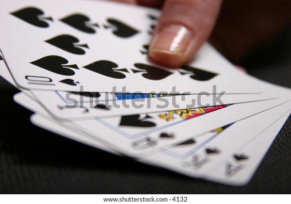 holding a hand of cards