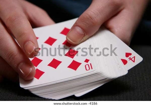 holding a hand in cards