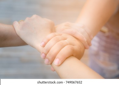 Holding hand to get commitment and collaboration as a teamwork to achieve the goal,