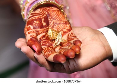 holding hand with holding ring